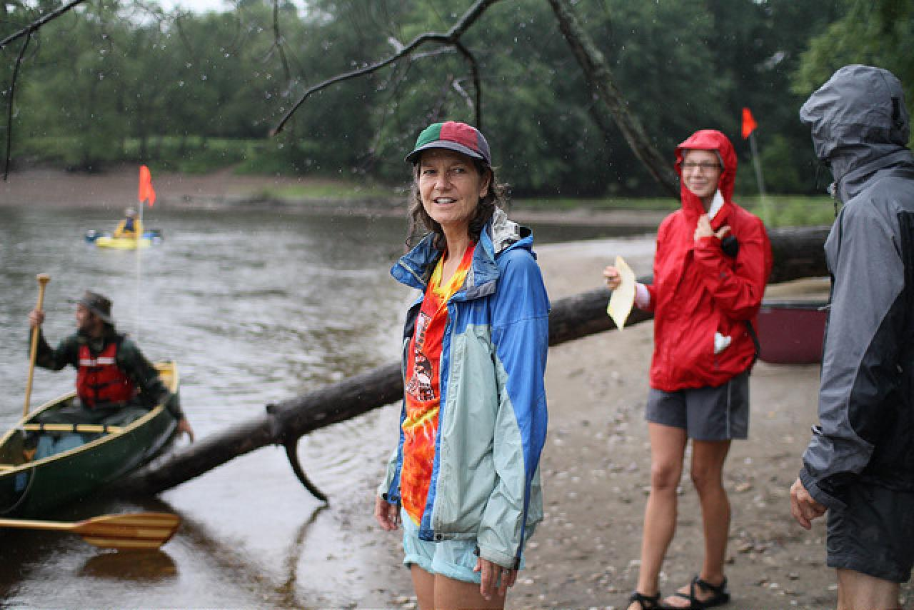 Michele Bevis ready to help a paddler come in off the river at an FMR event.