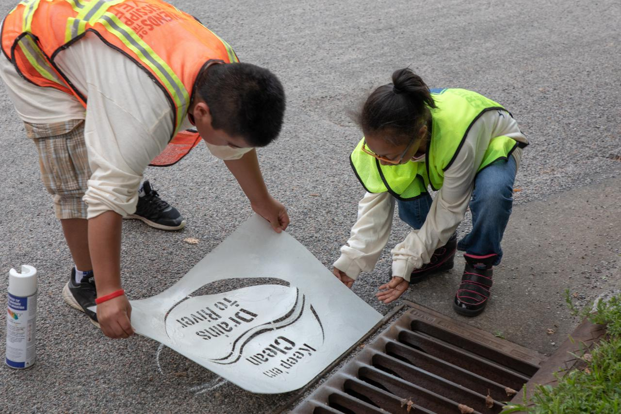 Stenciling storm drains in St. Paul