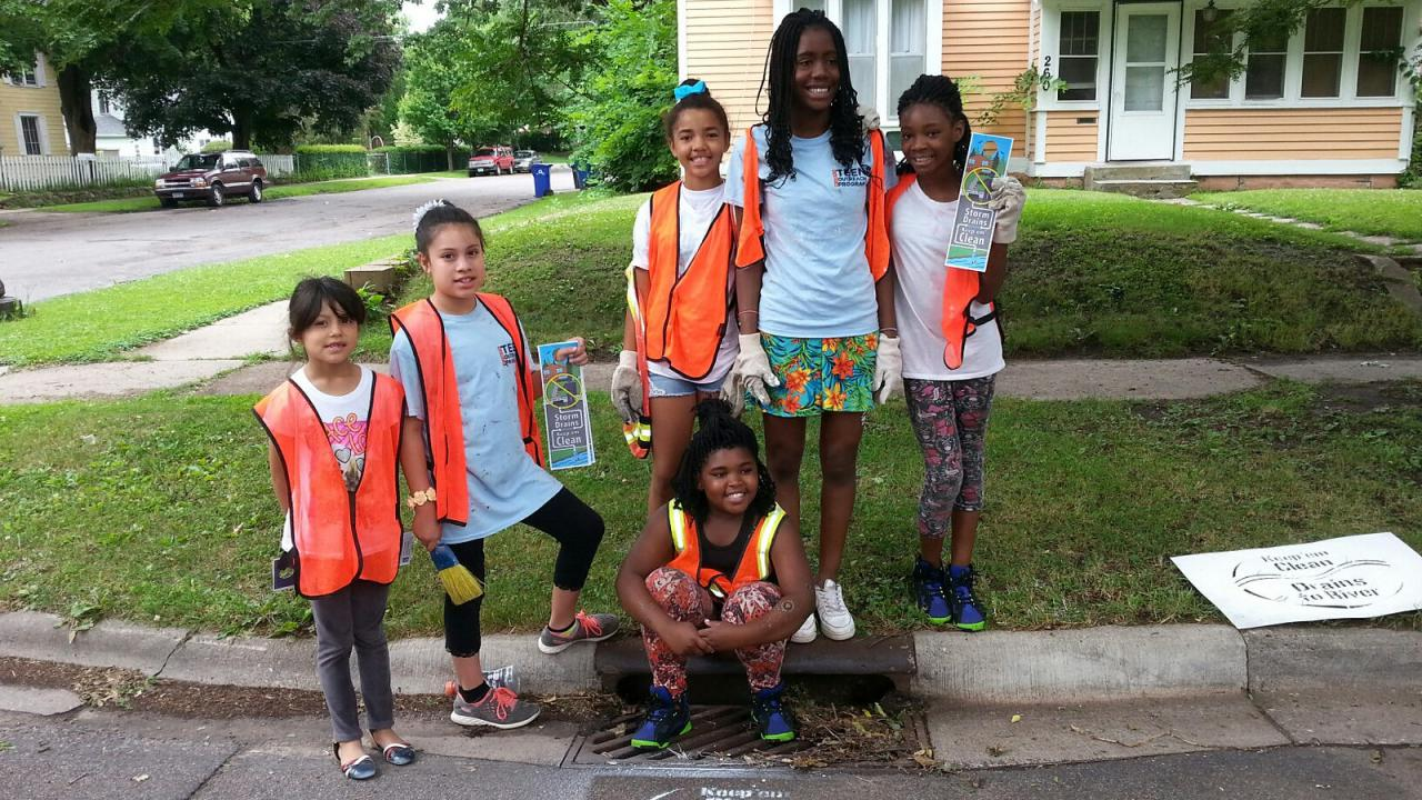 Students stencil storm drains in St. Paul neighborhoods