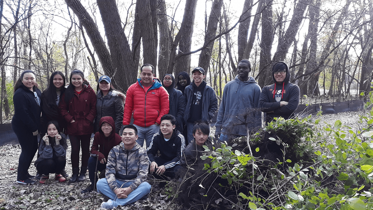 High School students assist FMR staff with removing buckthorn an invasive species at a restoration site