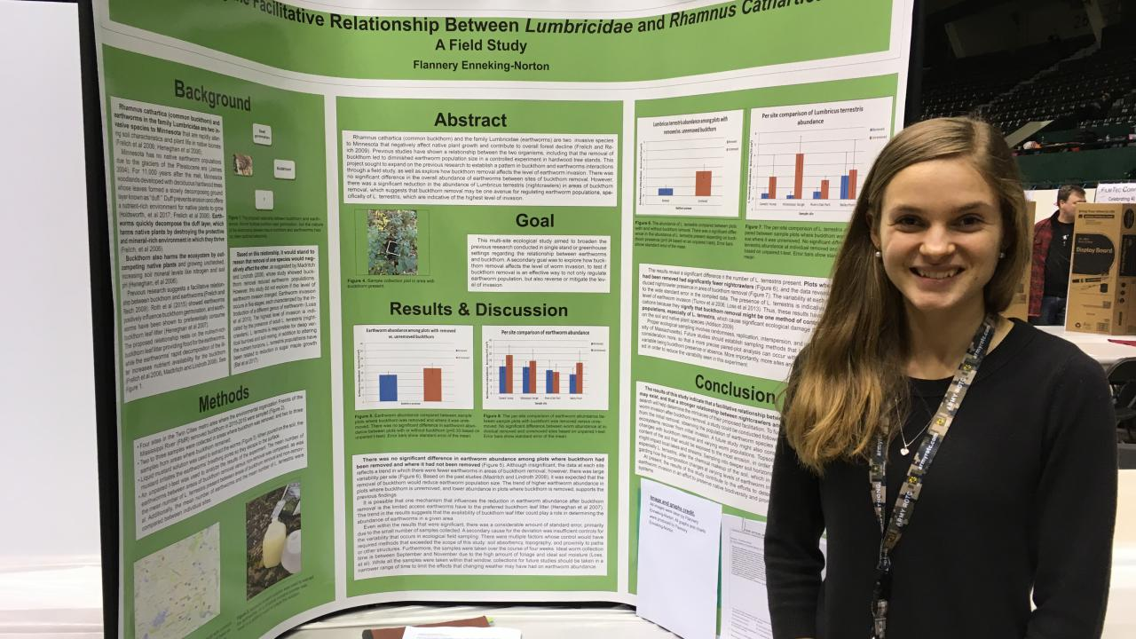 Flannery Enneking-Norton stands with her award-winning project at this month's Twin Cities Regional Science Fair.